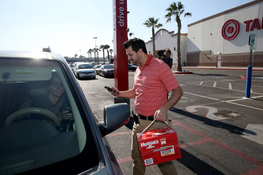 Greg Latter, a service and engagement executive, delivers delivers a curbside pickup order to C ...