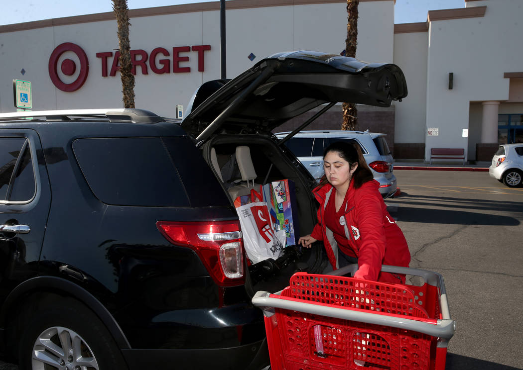 Guest service advocate Megan Philippi delivers a curbside pickup order at Target at 9725 S. Eas ...
