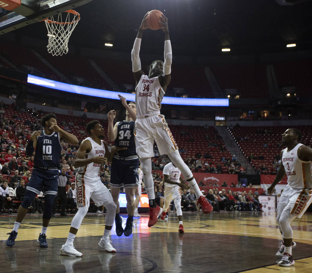 UNLV's forward Mbacke Diong (34) blocks a Utah State point during the second half of the game o ...