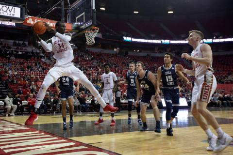 UNLV's forward Mbacke Diong (34) grabs the ball on defense as Utah State players look on during ...