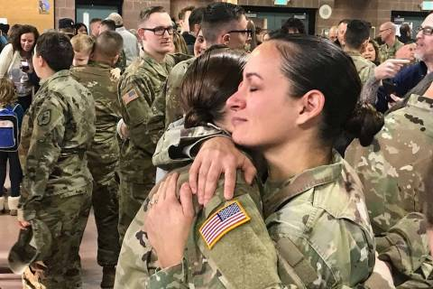 Sgt. 1st Class Luciana Irenze (right) hugs Sgt. Alison Martindale following the mobilization ce ...