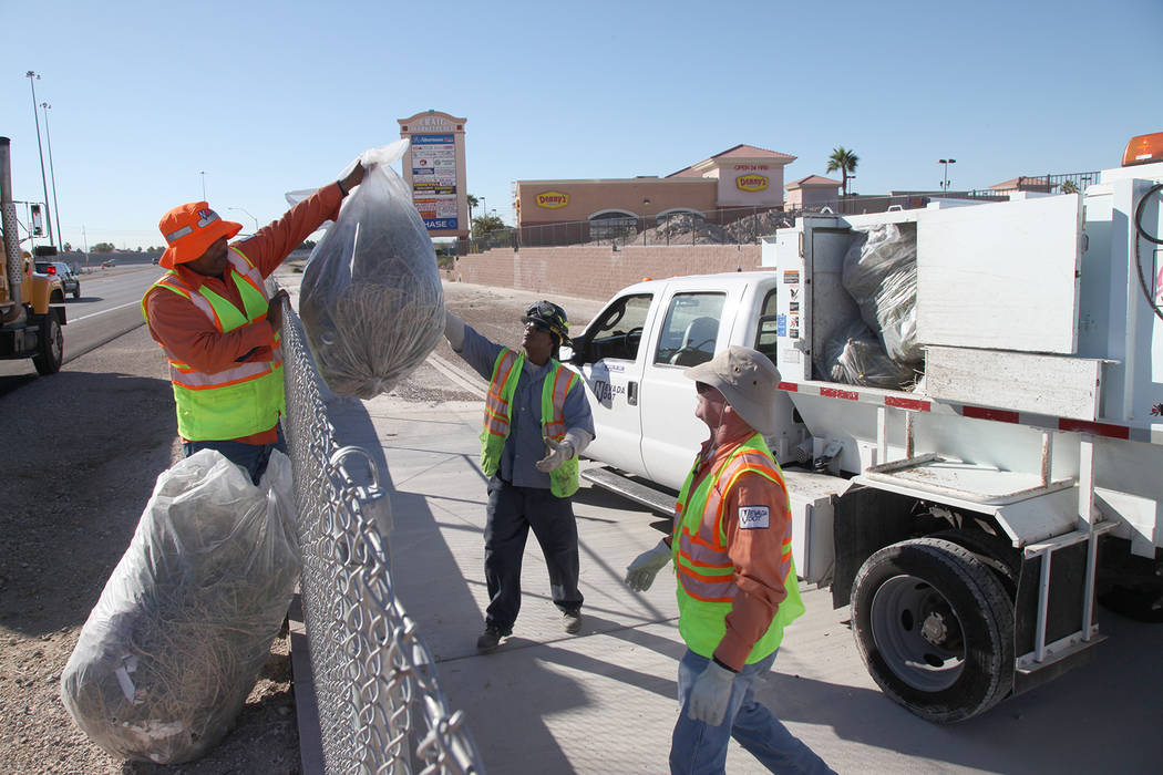 A Nevada Department of Transportation crew works to clean up debris. (Courtesy NDOT)