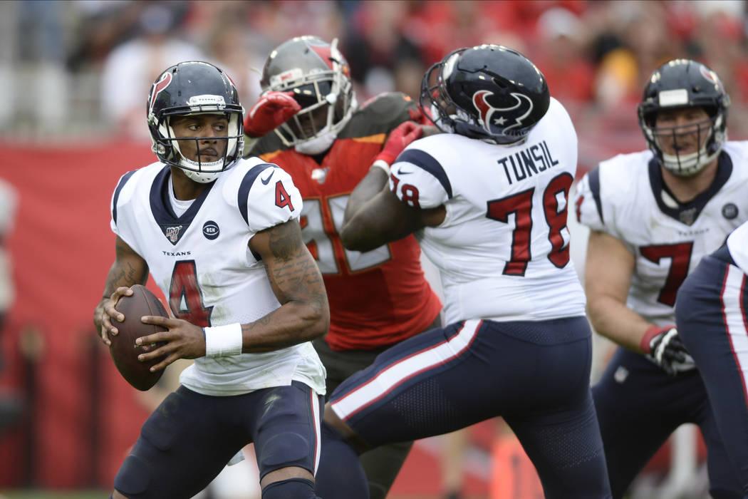 Houston Texans quarterback Deshaun Watson (4) looks to pass against the Tampa Bay Buccaneers du ...
