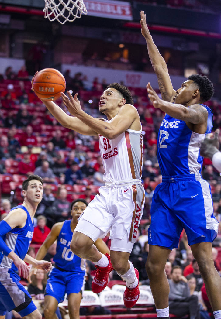 UNLV Rebels guard Marvin Coleman (31) gets inside of Air Force Falcons forward Lavelle Scottie ...