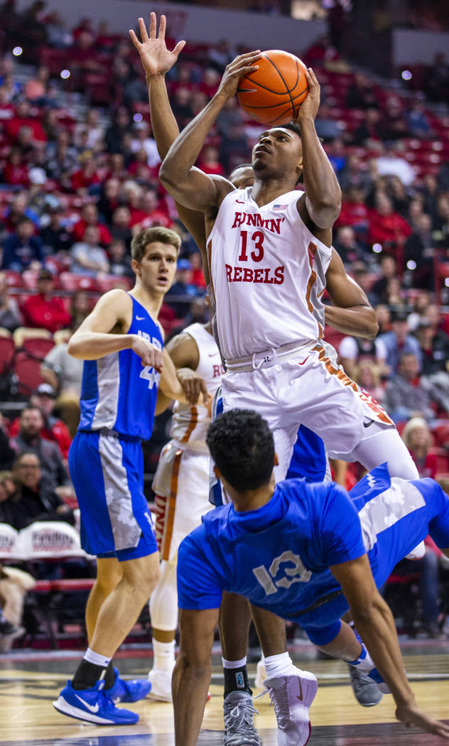 UNLV Rebels guard Bryce Hamilton (13) eyes a shot after taking a charge by Air Force Falcons gu ...