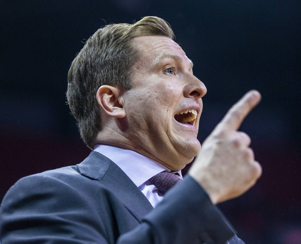 UNLV Rebels head coach T. J. Otzelberger continues to counsel his team versus the Air Force Fal ...