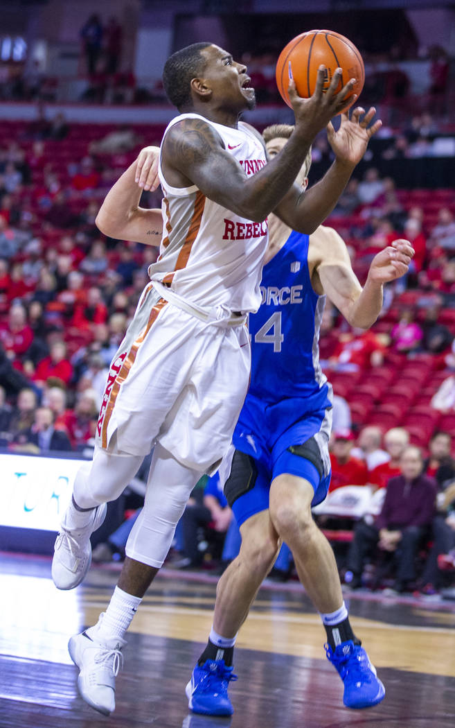 UNLV Rebels guard Amauri Hardy (3) gets inside of Air Force Falcons guard Marcus Hill (14) for ...