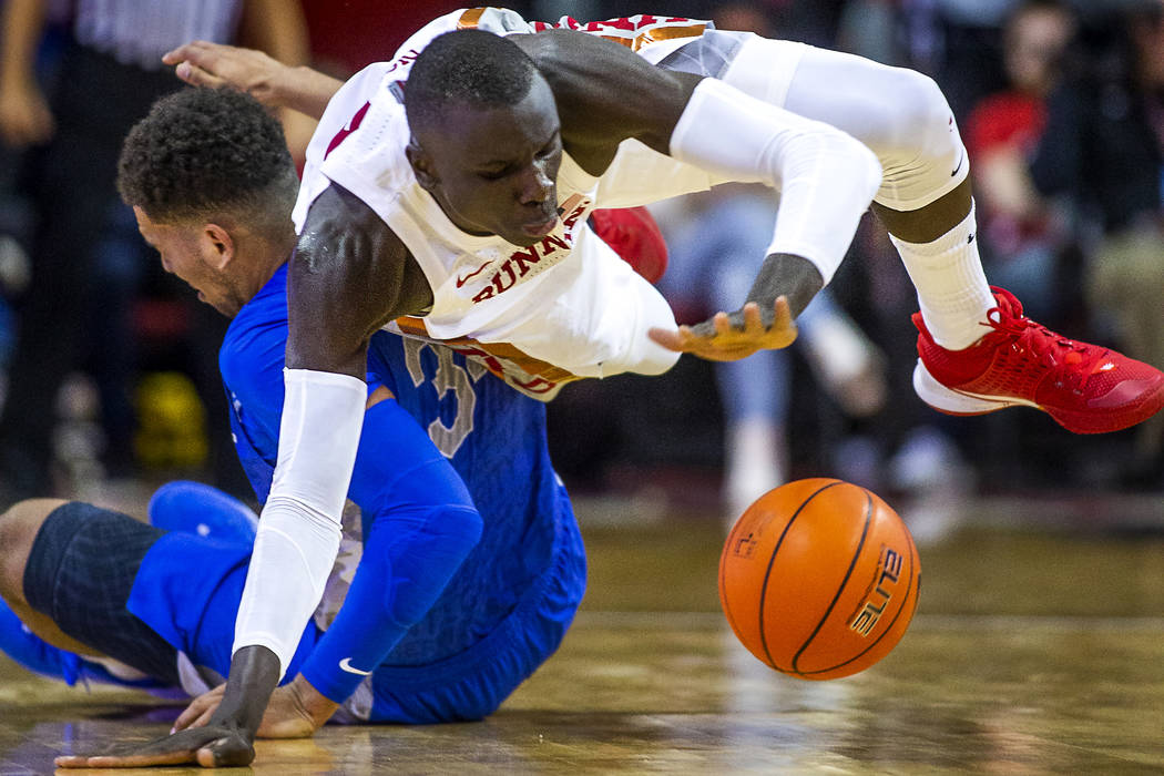 UNLV Rebels forward Cheikh Mbacke Diong (34) goes to the floor to steal the ball from Air Force ...
