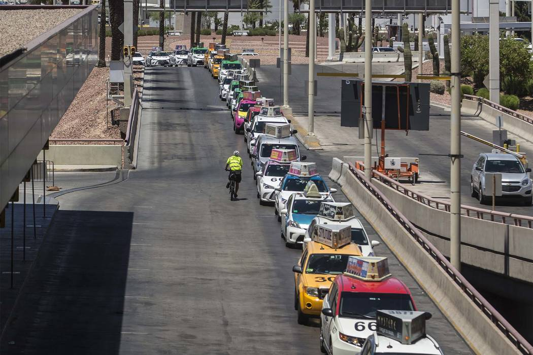 Taxis wait outside Terminal 1 at McCarran International Airport on Thursday, June 28, 2018, in ...