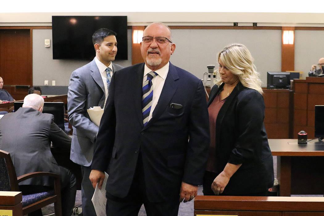 Las Vegas defense attorney Dominic Gentile, center, leaves a Regional Justice Center courtroom ...