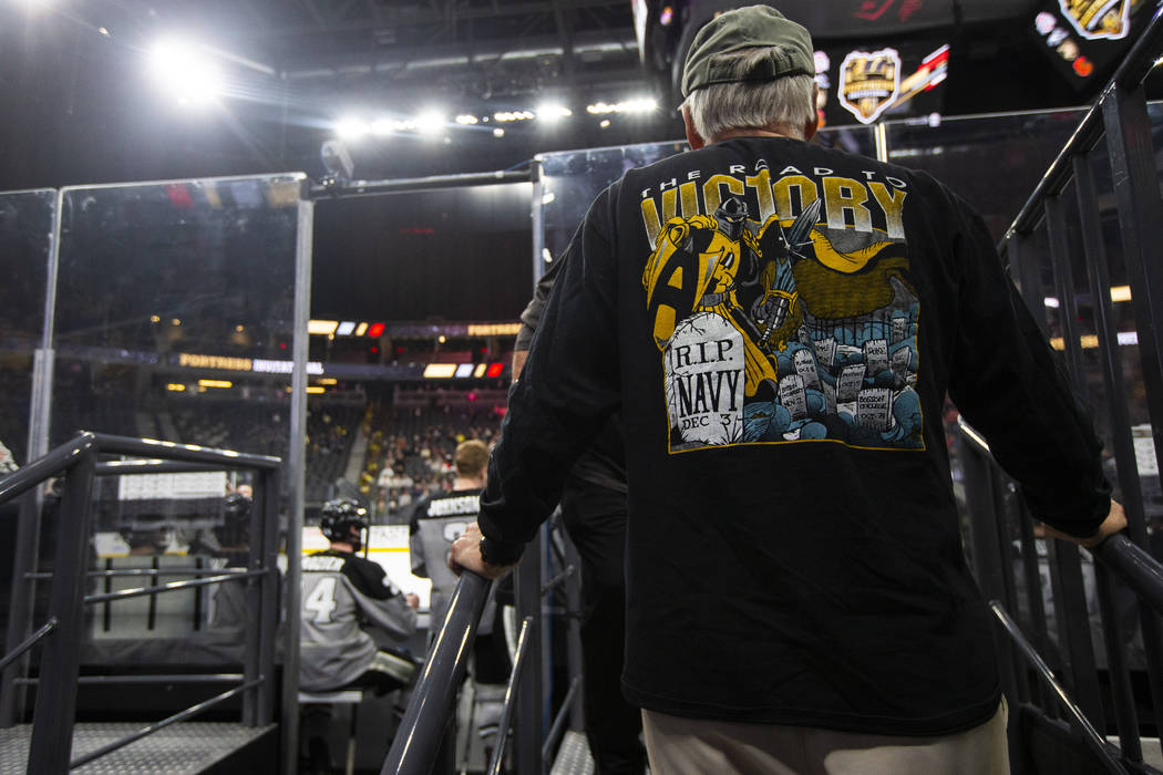 An Army fan watches as the team plays Providence during a Fortress Invitational hockey game at ...