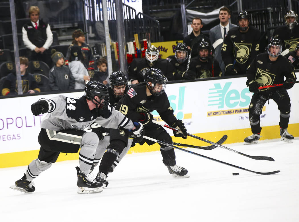 Army Black Knights' forward Brett Abdelnour (19) battles for the puck between Providence Friars ...