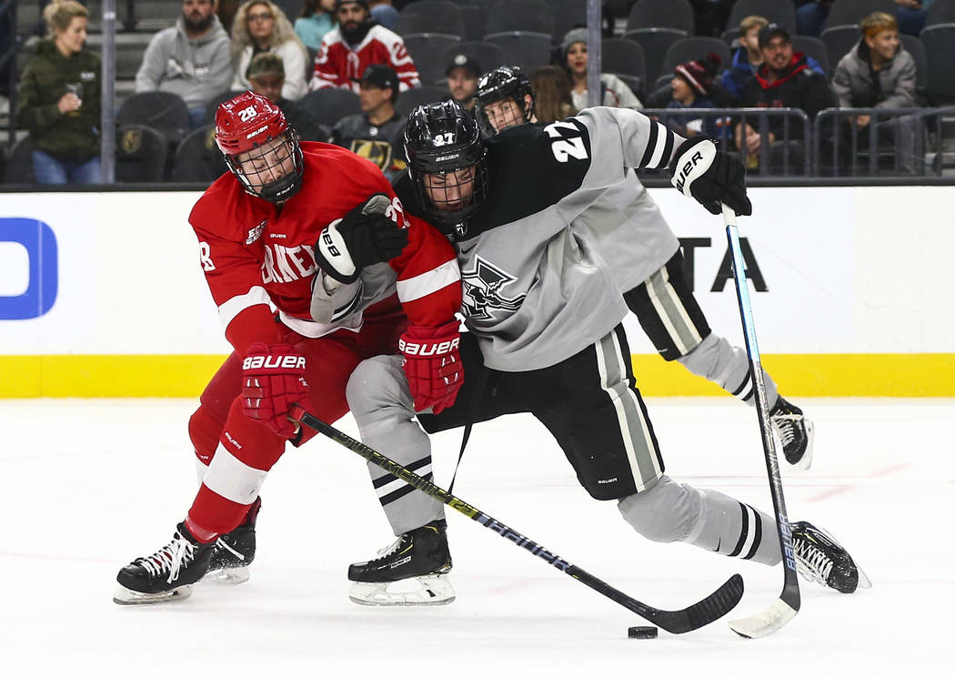 Cornell Big Red's Brenden Locke (28) and Providence Friars' Tyce Thompson (27) battle for the p ...