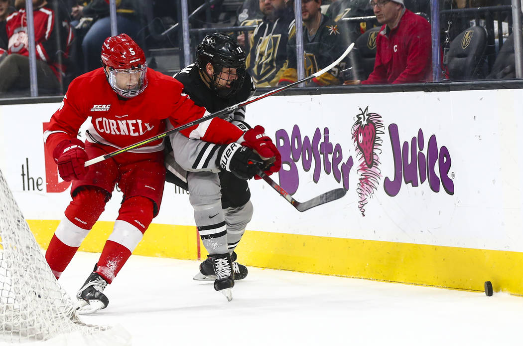 Cornell Big Red's Sebastian Dirven (5) and Providence Friars' Jack Dugan (12) battle for the pu ...