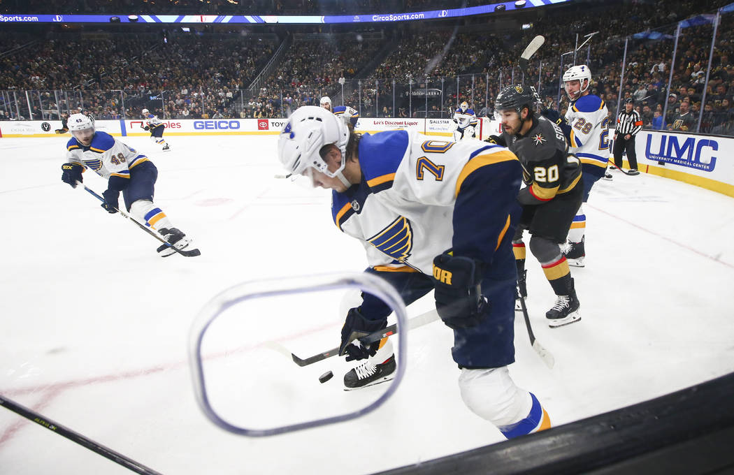 St. Louis Blues' Oskar Sundqvist (70) moves the puck in front of Golden Knights' Chandler Steph ...