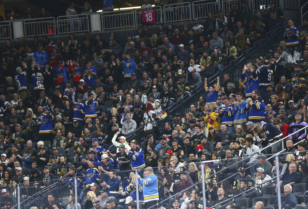 St. Louis Blues fans celebrate their team's first goal against the Golden Knights in the first ...