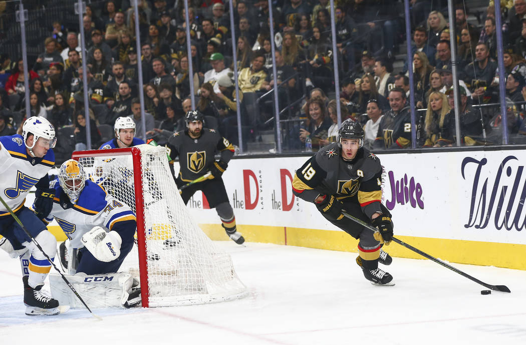 Golden Knights' Reilly Smith (19) moves the puck as St. Louis Blues goaltender Jake Allen (34) ...