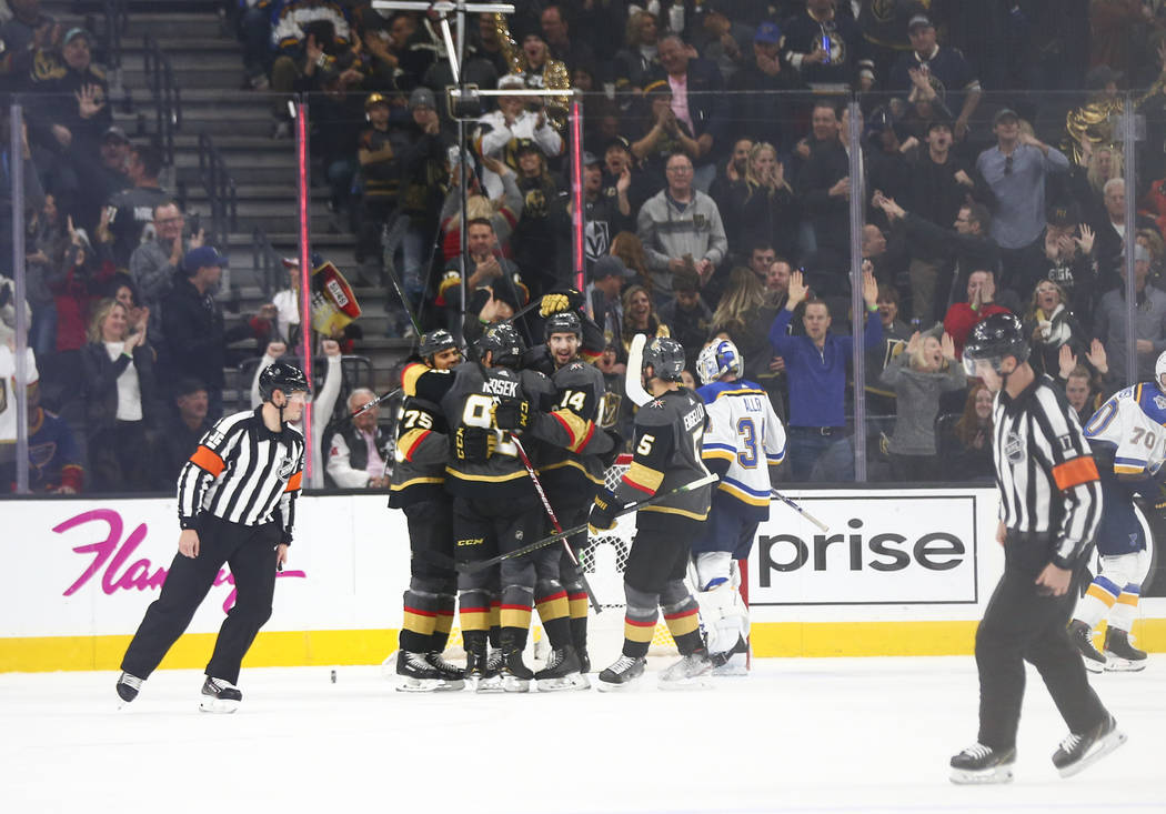 The Golden Knights celebrate a goal by Ryan Reaves during the second period of an NHL hockey ga ...