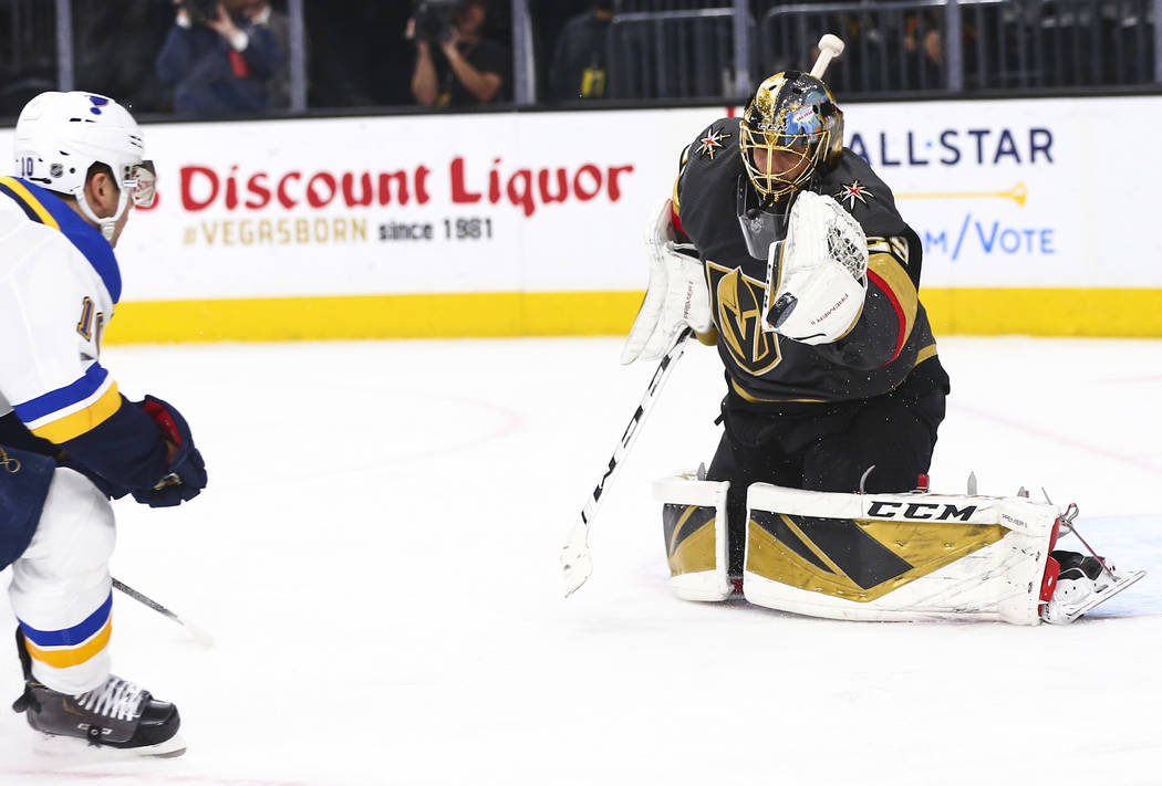 Golden Knights goaltender Marc-Andre Fleury (29) stops the puck in front of St. Louis Blues' Br ...