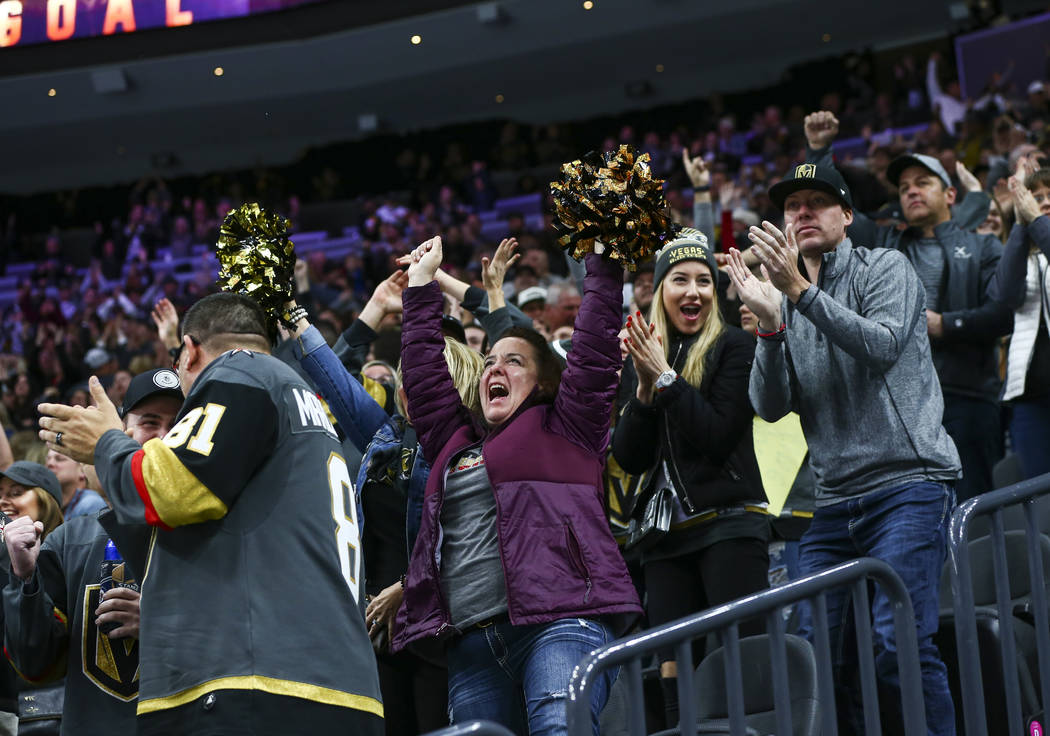 Golden Knights fans celebrate a goal by Golden Knights' Paul Stastny during the second period o ...