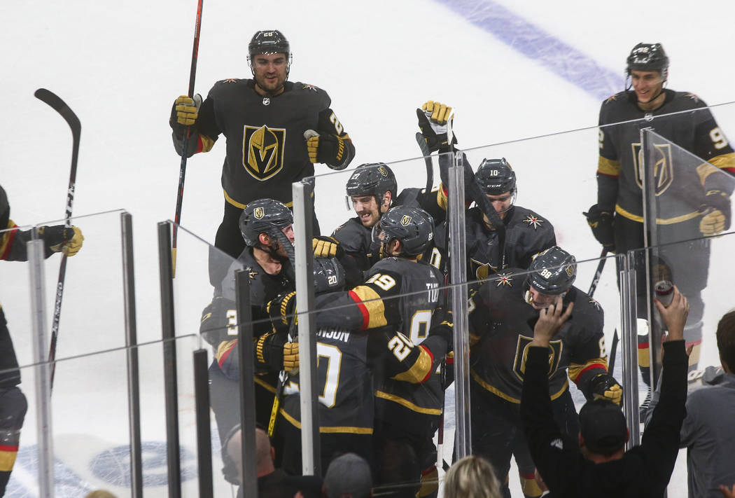 The Golden Knights celebrate a goal by Chandler Stephenson (20) to win in overtime against the ...