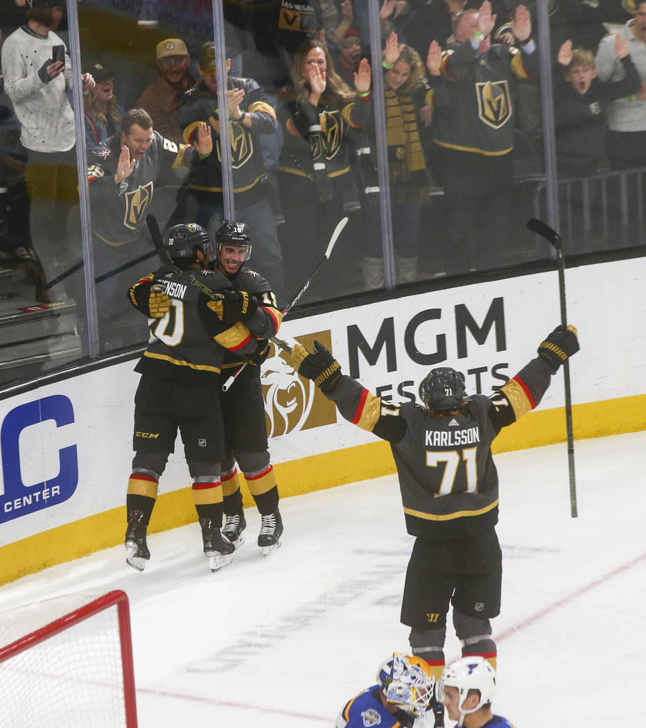 Golden Knights' Reilly Smith, second from left, celebrates his goal with Chandler Stephenson (2 ...
