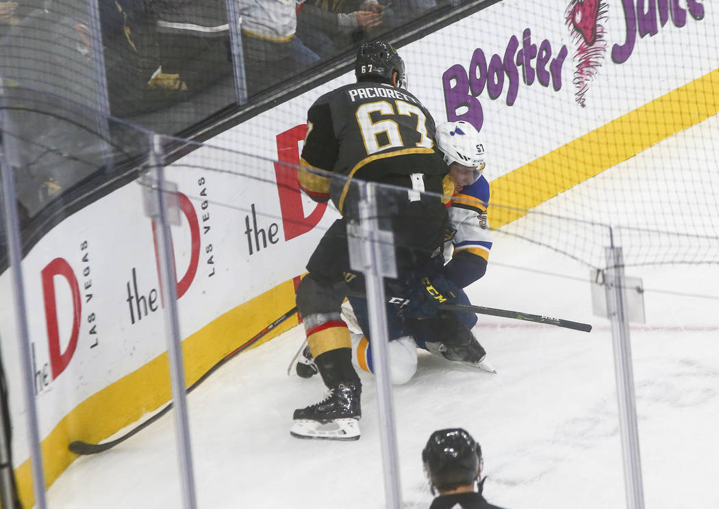 Golden Knights' Max Pacioretty (67) tries to fight St. Louis Blues' David Perron (57) during th ...