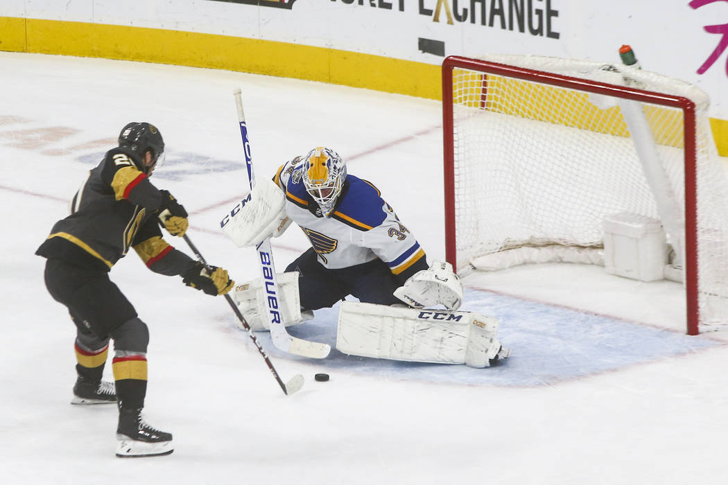 Golden Knights' Chandler Stephenson (20) lines up his game-winning shot against St. Louis Blues ...