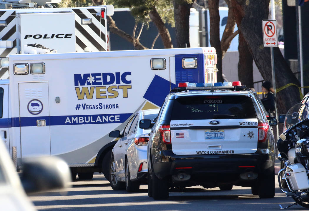 An ambulance leaves the scene as Las Vegas police are investigating officers involved in a shoo ...