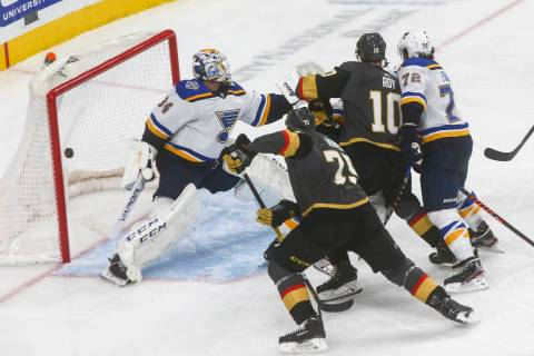 Golden Knights' Nicolas Roy (10) sends the puck past St. Louis Blues goaltender Jake Allen (34) ...
