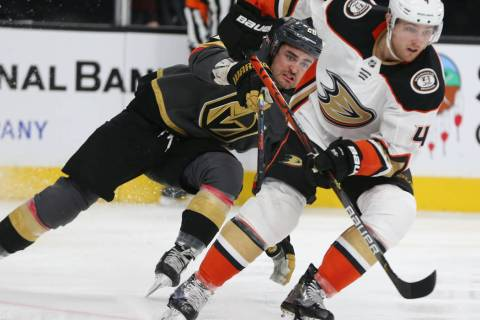 Vegas Golden Knights left wing William Carrier (28) chases Anaheim Ducks defenseman Cam Fowler ...