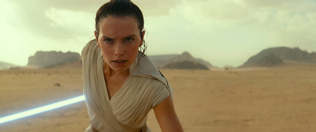 """This image released by Disney/Lucasfilm shows Daisy Ridley as Rey in a scene from """"Star Wars: T ..."""
