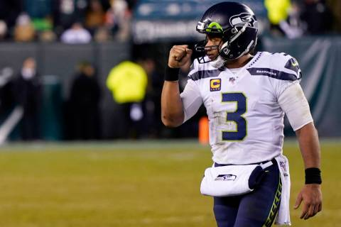 Seattle Seahawks' Russell Wilson reacts during the second half of an NFL wild-card playoff foot ...