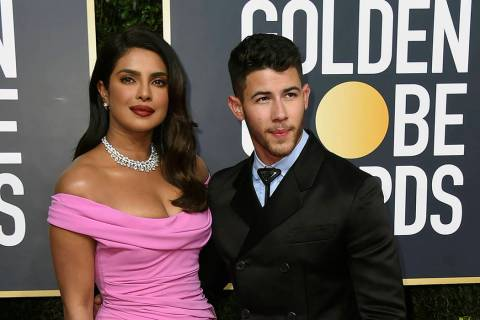 Priyanka Chopra, left, and Nick Jonas arrive at the 77th annual Golden Globe Awards at the Beve ...