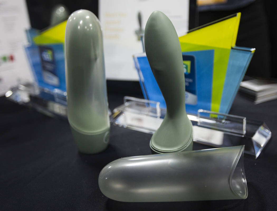 Onda, a robotic g-spot massager created by the sex toy company Lora DiCarlo, at their booth at ...