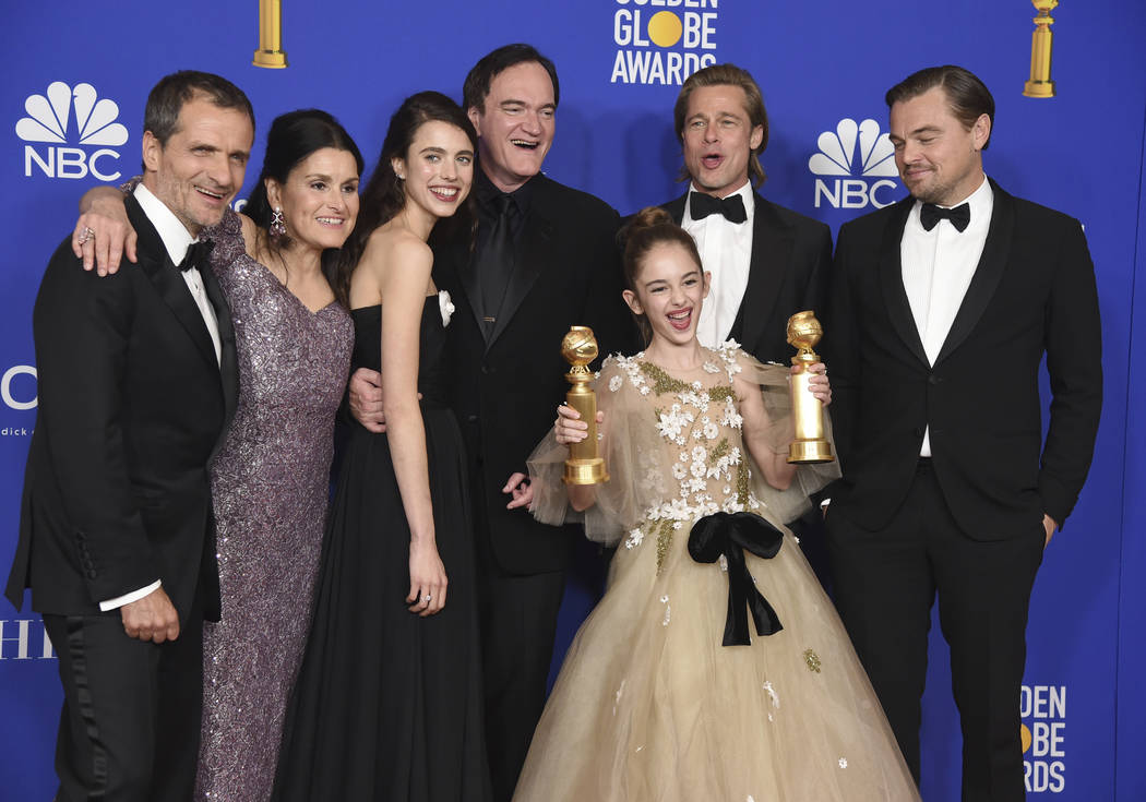 """The cast and crew of """"Once Upon a Time in Hollywood"""" pose in the press room with the ..."""
