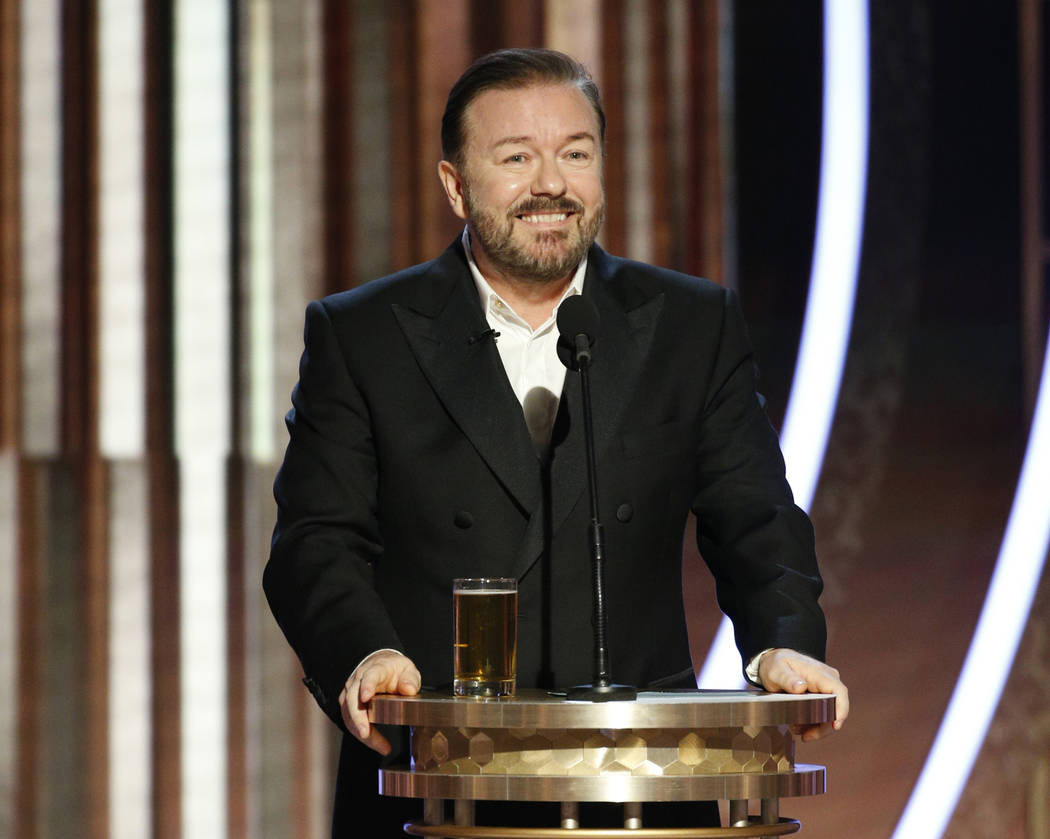This image released by NBC shows host Ricky Gervais speaking at the 77th Annual Golden Globe Aw ...