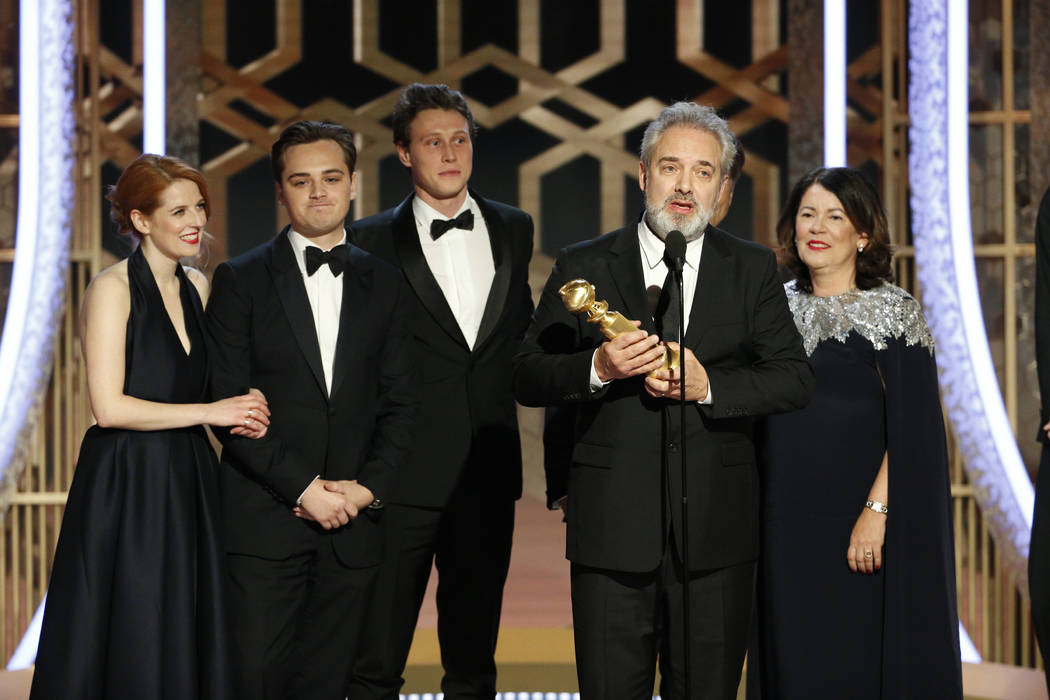 This image released by NBC shows filmmaker Sam Mendes accepting the award for best motion pictu ...