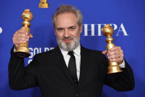 Sam Mendes poses in the press room with the awards for best director, motion picture and best m ...