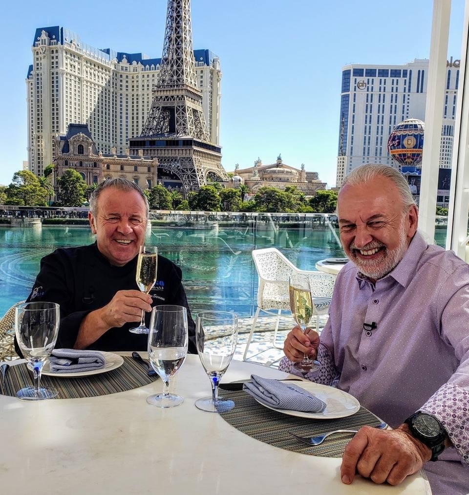 "Julian Serrano (left) and Hubert Keller sip champagne suring the filming of ""Hubert Keller: Sec ..."