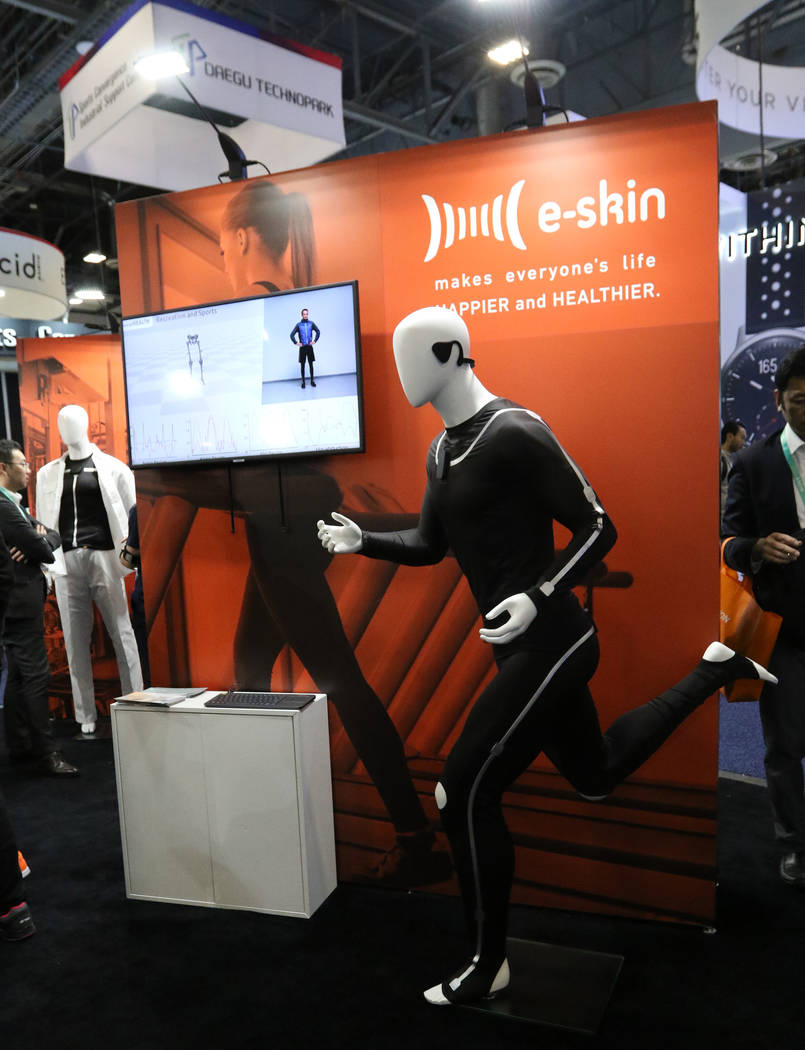 The E-Skin suit, a wearable fitness item, on display at the CES trade show at the Sands Expo Co ...