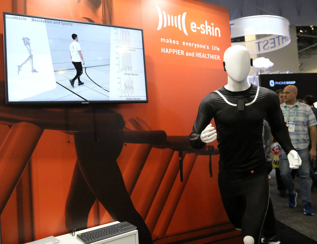 A wearable fitness item, the E-Skin suit, on display at the CES trade show at the Sands Expo Co ...