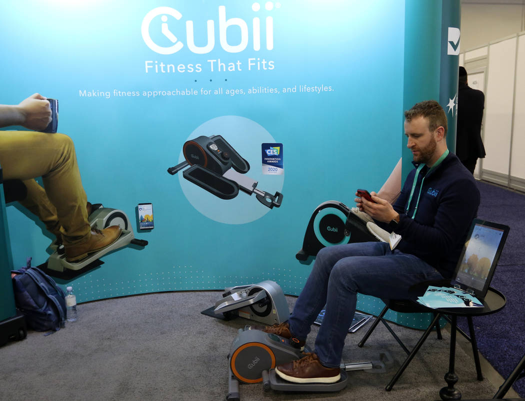 Jon Osting of Cubii displays how their compact elliptical works at the CES trade show at the Sa ...
