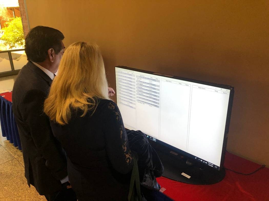 Family Judge Vincent Ochoa and wife Debra look for his name among a screen of judicial candidat ...