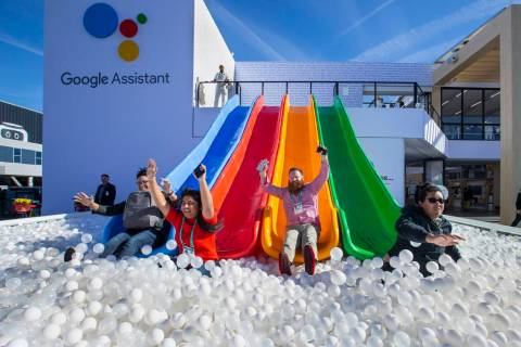 Robert McKenna, center, joins others down into a ball pit outside the Google display center on ...