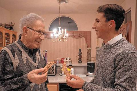 "Holocaust survivor Ben Lesser talks with Noah Geeser in a scene from ""Live to Bear Witness."" (J ..."