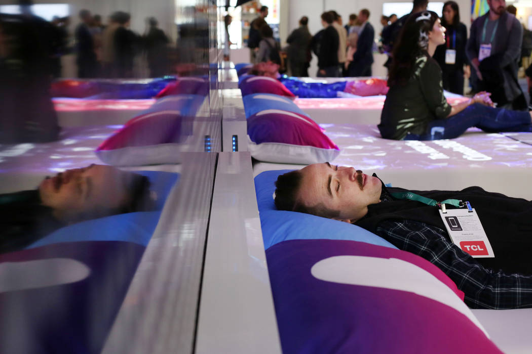 John Reynolds with Flexport lays on a CLIMATE360 Smart Bed by Sleep Number during the first day ...