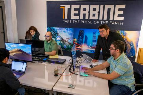 A team from Terbine works together at the International Innovation Center @ Vegas before addres ...