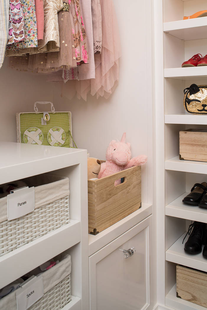 Bins and baskets are perfect for storing children's toys and accessories. (LA Closet Design)