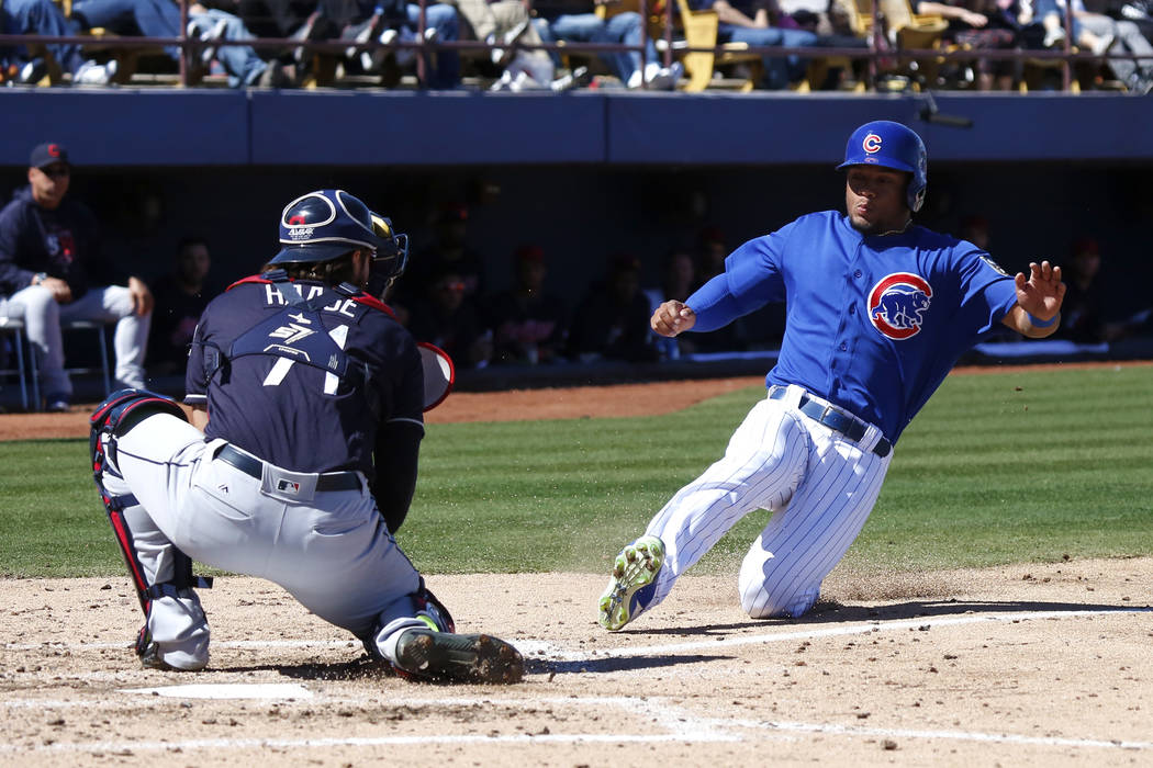 Chicago Cubs' Charcer Burks (54) slides into home plate during the annual Big League Weekend ba ...